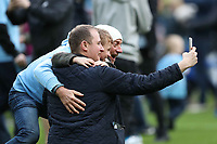 Three Manchester City fans takes a selfie after they invade the pitch after the Premier League match between Manchester City and Swansea City at the Etihad Stadium, Manchester, England, UK. Sunday 22 April 2018