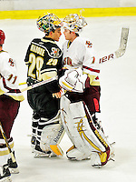 12 November 2010: University of Vermont Catamount goaltender Rob Madore, a Junior from Pittsburgh, PA, shakes hands and congratulates Boston College Eagle goaltender John Muse, a Senior from East Falmouth, MA, after a game at Gutterson Fieldhouse in Burlington, Vermont. The Eagles edged out the Cats 3-2 in the first game of their weekend series. Mandatory Credit: Ed Wolfstein Photo