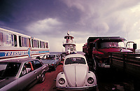 Tugboats push barges carrying cars, trucks and pedestrians across the very wide Rio Negro. Manaus Amazonas Brazil The Amazon.