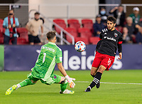 WASHINGTON, DC - MAY 13: Adrien Perez #16 of D.C. United takes a shot on Bobby Shuttleworth #1 of Chicago Fire FC during a game between Chicago Fire FC and D.C. United at Audi FIeld on May 13, 2021 in Washington, DC.