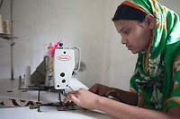 Nasima  Akhter, 19, survived the collapse of Rana Plaza on April 24, 2013. Nasima  and another four survivors now work in a model garment factory called 'Oporajeo', a worker-owned factory in Savar, near Dhaka, Bangladesh