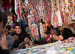 Women browse the jewelry section of the Tunis Medina in Tunisia.  The Medina of the Tunisian capital is a UNESCO World Heritage Site.