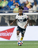 FOXBOROUGH, MA - JULY 18: Yordy Reyna #29 brings the ball forward during a game between Vancouver Whitecaps and New England Revolution at Gillette Stadium on July 18, 2019 in Foxborough, Massachusetts.