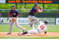Jason Martinson #11 of the Hagerstown Suns turns a double play as Hilton Richardson #15 of the Rome Braves slides into second base at State Mutual Stadium on May 2, 2011 in Rome, Georgia.   Photo by Brian Westerholt / Four Seam Images