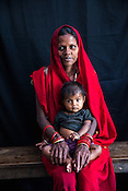 28 year old Asha Devi mandal poses for a portrait with her 11 months old daughter, Sharda at the government health centre in Hanuman Nagar in Saptari, Nepal.