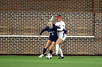 CHAPEL HILL, NC - NOVEMBER 16: Bridgette Andrzejewski #4 of the University of North Carolina holds off Erin Patterson #29 of Belmont University during a game between Belmont and North Carolina at UNC Soccer and Lacrosse Stadium on November 16, 2019 in Chapel Hill, North Carolina.