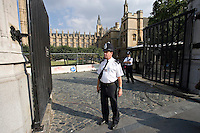 Armed Met Police Diplomatic Protection Group officers on duty outside Houses of Parliament and House of Lords London UK. This image may only be used to portray the subject in a positive manner..©shoutpictures.com..john@shoutpictures.com