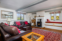 BNPS.co.uk (01202 558833)<br /> Pic: Savills/BNPS<br /> <br /> Pictured: The lounge room.<br /> <br /> A former tidal mill next to an impressive viaduct that looks like the perfect backdrop for a children's book is on the market for £3.5m.<br /> <br /> The Old Mill is over 600 years old and would be an ideal home for Swallows and Amazons or The Railway Children-inspired adventures.<br /> <br /> The impressive Grade II listed six-bedroom house has its own private harbour and panoramic views of the much-photographed Forder Railway Viaduct.<br /> <br /> It is only the second time the property in Cornwall has been on the market since 1886 and agents Savills say it is a once in a lifetime opportunity.