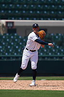 Detroit Tigers third baseman Spencer Torkelson (19) throws to first base during a Minor League Spring Training game against the Baltimore Orioles on April 14, 2021 at Joker Marchant Stadium in Lakeland, Florida.  (Mike Janes/Four Seam Images)