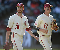 Arkansas starter Caleb Bolden (31) walks off the field Wednesday, April 7, 2021, alongside first baseman Brady Slavens during the fourth inning of the Razorbacks' 10-3 win over UALR at Baum-Walker Stadium in Fayetteville. Visit nwaonline.com/210408Daily/ for today's photo gallery. <br /> (NWA Democrat-Gazette/Andy Shupe)
