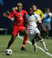 July 24, 2005: East Rutherford, NJ, USA:  DaMarcus Beasley (7)of the USMNT fights for the ball with Luis Moreno (3) of Panama during the CONCACAF Gold Cup Finals at Giants Stadium.