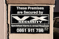 South Africa, Cape Town, Athlone Suburb.  Security Warning Sign on Private Residence.