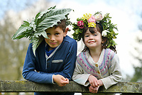 BNPS.co.uk (01202 558833)<br /> Pic: ZacharyCulpin/BNPS <br /> <br /> Weather input - <br /> <br /> Crowning glories: Dorset Flower Farmers, the Priestley family perfect their flower crown-making ahead of Garden Day on Sunday 9th May, the nationwide celebration of the benefits of gardens for health and wellbeing.  <br /> <br /> Pictured: Siblings Milo, 9, Arabella Priestley , 5, show off their flower crowns in the garden<br /> <br /> Garden Day will be back for a third successive year on Sunday, 9th May 2021 to celebrate outdoor and indoor garden spaces. The nationwide  movement is calling on plant-lovers to make a flower crown, and share their plant spaces with family and<br /> friends