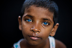 Pictured: Munna<br /> <br /> Family members with an unusual pigmentation show off their shockingly bright, blue eyes.  Eyes of this colour are rare for people of a darker skin tone, and the cause is a lack of melanin pigment in the iris of the eye.<br /> <br /> Lower levels of melanin are more commonly found in people with lighter skin tones, meaning they are more likely to have lighter coloured eyes.  The grandfather's name is Shukur Mia, who is photographed with his granddaughter Tasnim, 11, and grandson Mehedi, 6.  SEE OUR COPY FOR DETAILS.<br /> <br /> Please byline: Sultan Ahmed Niloy/Solent News<br /> <br /> © Sultan Ahmed Niloy/Solent News & Photo Agency<br /> UK +44 (0) 2380 458800