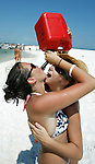 "Lindsey McKendrea (L) and her friend Sissy Mauney, both from Yulee, Florida, drink ""Chirp Chirp"" from a gasoline can at the 2006 White Trash Bash on Dog Island May 28, 2006, off the coast of Carrabelle, FL.  McKendrea described Chirp Chirp as an upside down margarita.  The White Trash Bash is a yearly boat party at Dog Island, 75 miles south of Tallahassee, Florida, which is a remote island that is only reachable by boat.  This year's party drew thousands in over 350 boats.   (Mark Wallheiser/TallahasseeStock.com)"