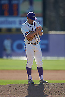 High Point Panthers relief pitcher Carson Jackson (10) rubs up the baseball during the game against the NJIT Highlanders at Williard Stadium on February 19, 2017 in High Point, North Carolina. The Panthers defeated the Highlanders 6-5. (Brian Westerholt/Four Seam Images)