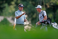 3rd July 2021, Detroit, MI, USA;  Bubba Watson talks to his caddie on the 9th tee on July 3, 2021 during the Rocket Mortgage Classic at the Detroit Golf Club in Detroit, Michigan.