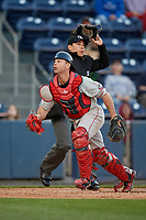 Pawtucket Red Sox catcher Dan Butler (12) looks for a foul ball popup in front of umpire Mike Wiseman during a game against the Scranton/Wilkes-Barre RailRiders on May 15, 2017 at PNC Field in Moosic, Pennsylvania.  Scranton defeated Pawtucket 8-4.  (Mike Janes/Four Seam Images)