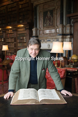 Robert Gascoyne-Cecil, Lord Salisbury at Hatfield House, Hatfield. Hertfordshire UK. Seen here with the King James Bible in the library. 2011