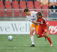 18 July 2009: Houston Dynamo defender Geoff Cameron #20 and Toronto FC midfielder Dewayne DeRosario #14 in action during a game between the Toronto FC and Houston Dynamo..The game ended in a 1-1 draw..