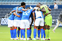 KANSAS CITY, KS - JULY 15: Haiti players in a pre game huddle during a game between Canada and Haiti at Children's Mercy Park on July 15, 2021 in Kansas City, Kansas.