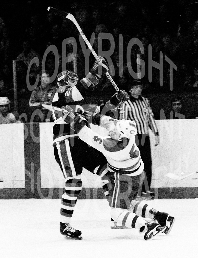 Ed Hospodar Ottawa 67's breaks Kingston Canadians Brian Crombeen's jaw 1977. Photo Scott Grant