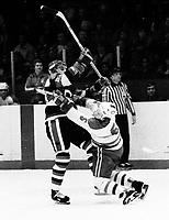 Ed Hospodar Ottawa 67's breaks Kingston Canadians Brian Crombeen's jaw 1977. Photo Scott Grant
