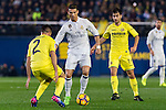 Cristiano Ronaldo (c) of Real Madrid competes for the ball with Mario Gaspar Pérez Martínez (l) of Villarreal CF during their La Liga match between Villarreal CF and Real Madrid at the Estadio de la Cerámica on 26 February 2017 in Villarreal, Spain. Photo by Maria Jose Segovia Carmona / Power Sport Images