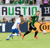 AUSTIN, TX - JUNE 19: Zan Kolmanic #21 of Austin FC looks to pass the ball with Cristian Espinoza #10 of the SJ Earthquakes chasing him during a game between San Jose Earthquakes and Austin FC at Q2 Stadium on June 19, 2021 in Austin, Texas.