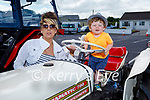 Lorcan Stackpoole sitting on a tractor next to his mom Caroline O'Flaherty in Ballyduff at the Vintage Tractor Run on Sunday.