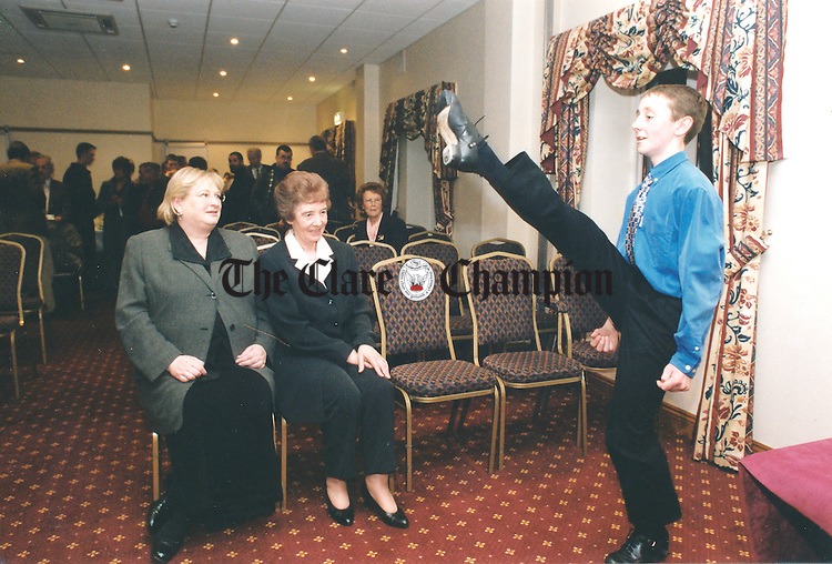 Gary Collins, who came sixth in the World U-13 to 15 Irish Dancing Championships, demonstrating his high-kicking skills to Minister Síle DeValera and Una Uí Mhurchu at the official launch of the Fleadh Nua programme at the Temple Gate Hotel, Ennis - May 5, 2000. Photograph by John Kelly