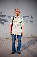 Maguanguan, a remodeler, age 54, poses for a portrait in Beijing. Response to 'What does China mean to you?': 'China is our home. The family spring from which I started my life journey.'  Response to 'What is your role in China's future?': 'A Chinese citizen.'