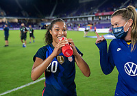 ORLANDO, FL - FEBRUARY 24: Margaret Purce #20 of the USWNT talks with Alyssa Naeher #1 after a game between Argentina and USWNT at Exploria Stadium on February 24, 2021 in Orlando, Florida.