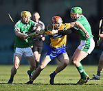 Peter Duggan of  Clare  in action against Paul Browne and Seamus Hickey of  Limerick during their NHL quarter final at the Gaelic Grounds. Photograph by John Kelly.