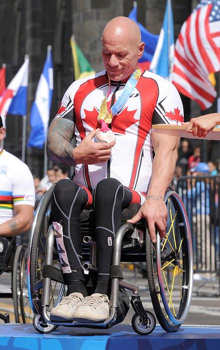 Rico Morneau, Guadalajara 2011 - Para Cycling // Paracyclisme.<br /> Rico Morneau on his way to receiving his bronze medal // Rico Morneau en route pour recevoir sa médaille de bronze. 11/12/2011.