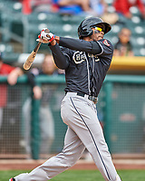 Franchy Cordero (10) of the El Paso Chihuahuas follows through with his swing against the Salt Lake Bees in Pacific Coast League action at Smith's Ballpark on April 30, 2017 in Salt Lake City, Utah.  El Paso defeated Salt Lake 3-0. This was Game 1 of a double-header. (Stephen Smith/Four Seam Images)