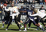 Idaho quarterback Brian Reader (14) throws under pressure from Nevada during the first quarter of an NCAA football game in Reno, Nev., on Saturday, Dec. 3, 2011.  Nevada won 56-3..Photo by Cathleen Allison