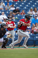 Noah Campbell (8) of the Carolina Mudcats follows through on his swing against the Kannapolis Cannon Ballers at Atrium Health Ballpark on July 18, 2021 in Kannapolis, North Carolina. (Brian Westerholt/Four Seam Images)