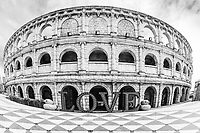 Black-and-white fisheye view of the Roman amphitheater coliseum in Macao, with a big love sign and duck statues, in fisherman's wrap, China
