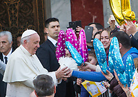 Pope Francis, is given a dove by o group of childrenas he arrives at the Basilica of Santa Sofia to visit the Ukrainian greek-catholic community, in Rome January 28, 2018.<br /> <br /> UPDATE IMAGES PRESS/Riccardo De Luca<br /> <br /> STRICTLY ONLY FOR EDITORIAL USE