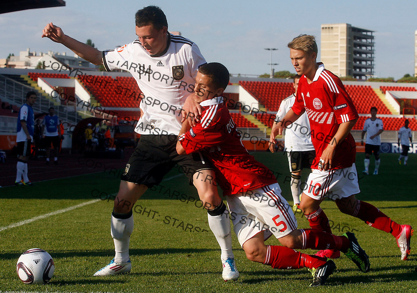 Nils Quaschner (L) of Germany is challenged by Riza Durmisi of Denmark during the UEFA U-17 championships Semi Final match between Denmark and Germany on May 12, 2011 in Novi Sad, Serbia.(Photo by Srdjan Stevanovic/Starsportphoto.com)