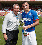 First trophy of the season as Ally McCoist and captain Lee McCulloch take the Blackthorn Cup after the challenge match in Bristol