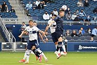 KANSAS CITY, KS - MAY 16: Andreu Fontas #3 Sporting KC heads  the ball clear during a game between Vancouver Whitecaps and Sporting Kansas City at Children's Mercy Park on May 16, 2021 in Kansas City, Kansas.