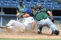 Asheville Tourists third baseman Sam Mende #3 slides in under the tags of Jeff Arnold during a game against the Augusta GreenJackets at McCormick Field Field on July 8, 2012 in Asheville, North Carolina. The Tourists defeated the GreenJackets 3-2. (Tony Farlow/Four Seam Images).
