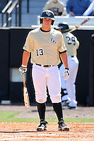 UCF Knights outfielder James Vasquez #13 at bat during a game against the Siena Saints at the UCF Baseball Complex on March 4, 2012 in Orlando, Florida.  Central Florida defeated Siena 15-2.  (Mike Janes/Four Seam Images)