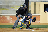 Quinnipiac Bobcats catcher Matthew Oestreicher (20) sets a target as home plate umpire Randal Dulin looks on during the game against the Radford Highlanders at David F. Couch Ballpark on March 4, 2017 in Winston-Salem, North Carolina. The Highlanders defeated the Bobcats 4-0. (Brian Westerholt/Four Seam Images)