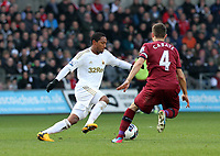 Pictured: Swansea's Jonathan De Guzman takes on Yohan Cabaye<br /> Saturday 2nd March 2013<br /> Re: Barclays Premier League, Swansea City V Newcastle United, Liberty Stadium.