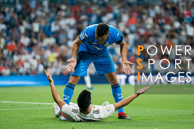 Marco Asensio Willemsen of Real Madrid and Bruno Gonzalez Cabrera of Getafe CF during the La Liga 2018-19 match between Real Madrid and Getafe CF at Estadio Santiago Bernabeu on August 19 2018 in Madrid, Spain. Photo by Diego Souto / Power Sport Images