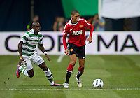 July 16, 2010 Chris Smalling No. 12 of Manchester United and Marc Fortune No. 10 of Celtic FC during an international friendly between Manchester United and Celtic FC at the Rogers Centre in Toronto.