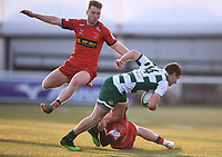 20th February 2021; Trailfinders Sports Club, London, England; Trailfinders Challenge Cup Rugby, Ealing Trailfinders versus Doncaster Knights; Tom Bacon of Doncaster Knights tackles Luke Daniels of Ealing Trailfinders while Howard Packman of Doncaster Knights hurdles the bodies on the ground